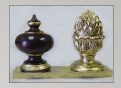 Mahogany finial trimmed with gold leaf; gold leaf over burgundy