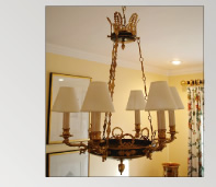 Chandelier with tete de negre and gold leaf