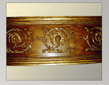 French walnut with gilded ornamentation and molding