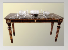 Mahogany table trimmed with gold leaf